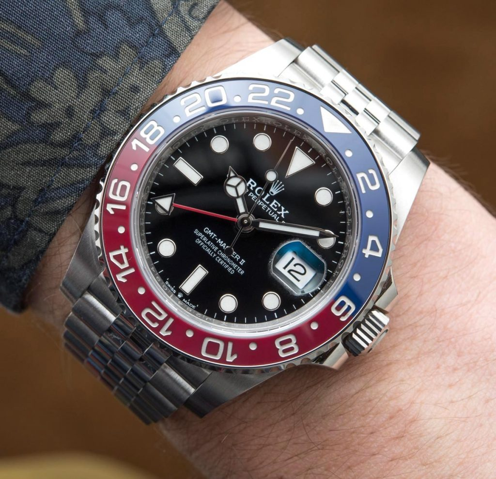 The luxury replica watches have blue and red ceramic bezels.
